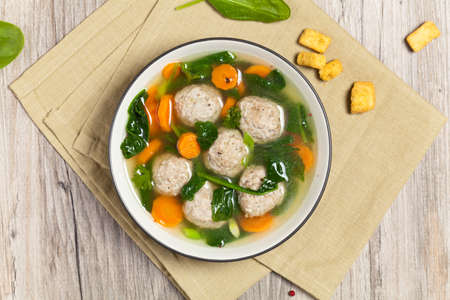 croutons: Spinach and Chicken meatball soup Stock Photo