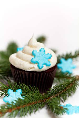 Cupcake with snowflake shaped sugar photo