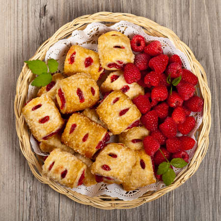 danish puff pastry: Raspberry filled pastries with sugar sprinkles. Selective focus.