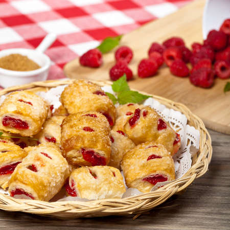 Raspberry filled pastries with sugar sprinkles. Selective focus. photo