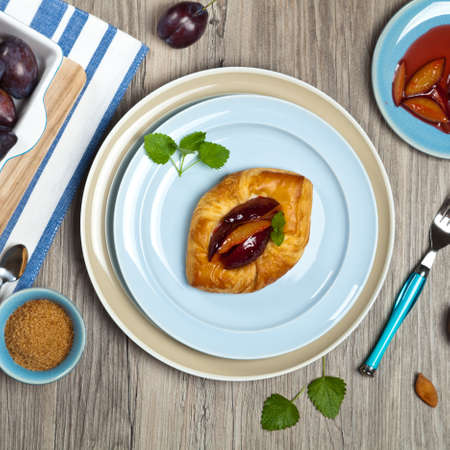 danish puff pastry: Plums pastries Stock Photo
