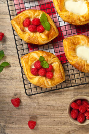 danish puff pastry: Raspberry pastries with sugar sprinkles. Selective focus.