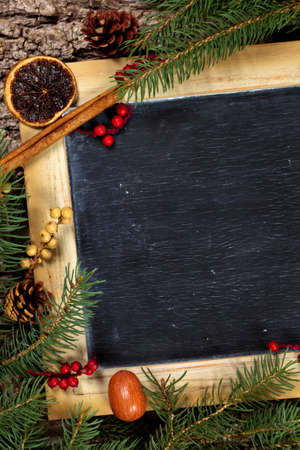 Holiday Decorations. Christmas composition with chalkboard. Selective focus. photo