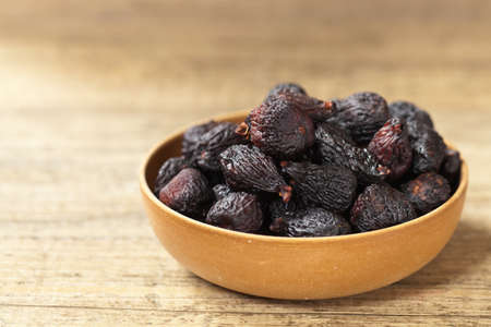 Black dried figs. Selective focus. Stock Photo