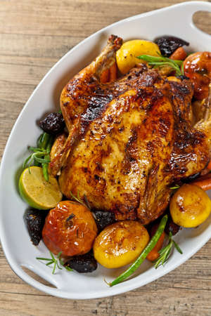 Whole Roasted Holiday Chicken With Potatoes and Apples photo