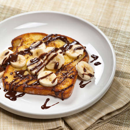 French Toast with Bananas and Chocolate sauce. Selective focus.
