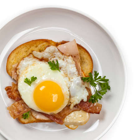 turkey bacon: Traditional French Toasted Sandwich with fried eggs - Croque Madame. Selective focus.