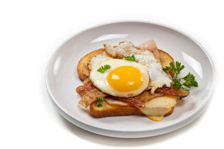 toasted sandwich: Traditional French Toasted Sandwich with fried eggs - Croque Madame. Selective focus.