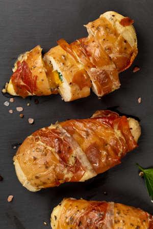 chicken breast: Prosciutto Wrapped Chicken breast. Selective focus.
