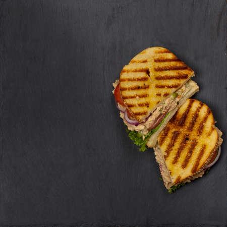 tuna mayo: Grilled Tuna Panini Sandwich. Selective focus. Stock Photo