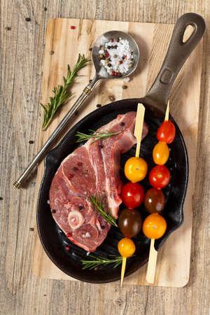 chops: Raw Lamb Chops. Selective focus. Stock Photo