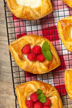 danish puff pastry: Raspberry pastries. Selective focus.