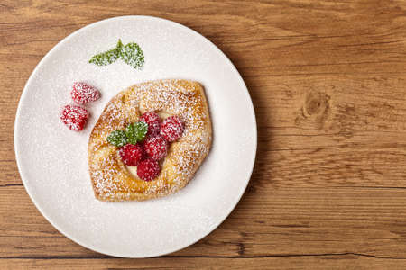 Raspberry pastries with powdered sugar. Selective focus. photo