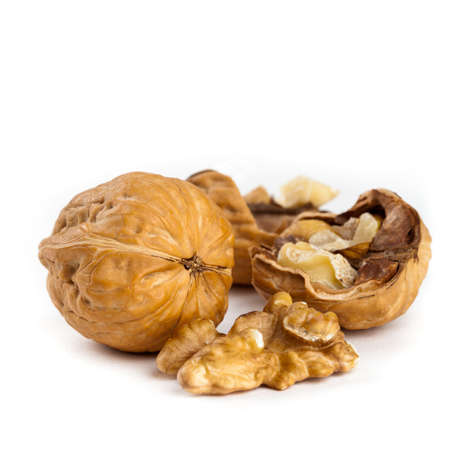 Walnuts on white background. Selective focus.