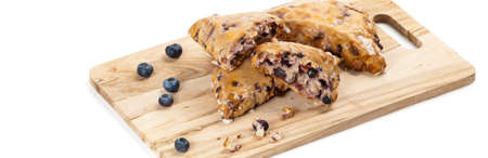 scones: Blueberry Scones on white background. Selective focus. Stock Photo