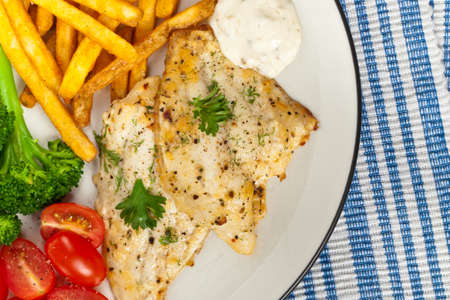 whitefish: Baked white fish fillet. Selective focus.