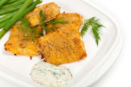 fish fillet: Baked white fish fillet. Selective focus.