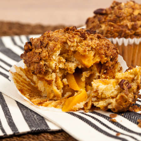 buttery: Peach Muffins with Buttery Pecan Topping. Selective focus.