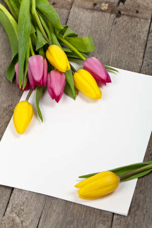retro flowers: Bouquet of Tulips on wood table with space for text. Selective focus. Stock Photo