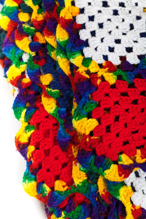 acrylic yarn: Fragment of Blanket made of granny Squares. Selective focus.