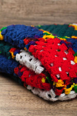 thrifty: Fragment of Blanket made of granny Squares. Selective focus.
