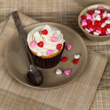 frosting': Cupcakes with frosting and hearts. Selective soft focus.