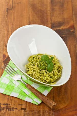 reg: Spaghetti with pesto and basil. Selective focus. Stock Photo
