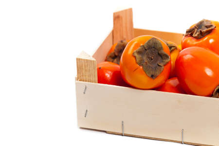 Orange Persimmons on white background. Selective focus.