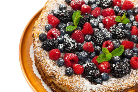 Very Berry Coffee Cake on white background. Selective focus.