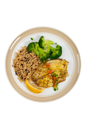 whitefish: Fish dish - fried fish fillet with vegetables on white background. Selective focus.