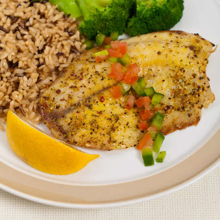 whitefish: Tilapia Fish with Broccoli and Brown Rice. Selective focus.