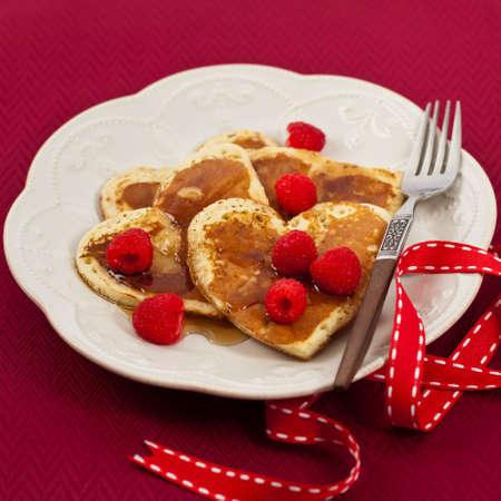 Heart Shaped Valentines Day Pancakes. Selective focus. Stock Photo