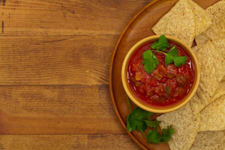 food backgrounds: Chunky Salsa and tortilla chips. Selective focus.