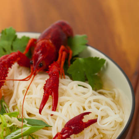 red food: Crawfish Noodle Soup. Selective focus.