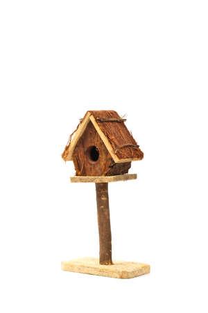 decorative item: Bird Box - Bird House Nest Box Decorative Item Isolated on white background. Selective focus. Stock Photo