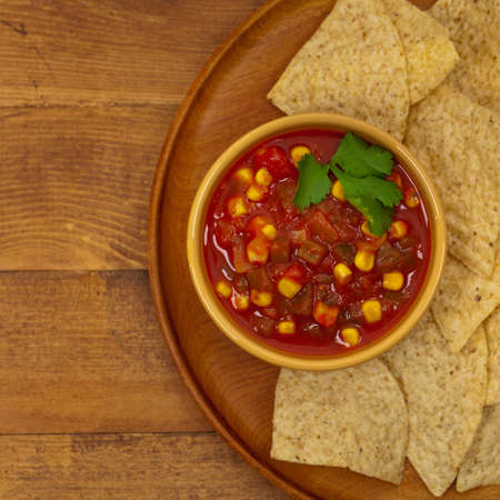 chips and salsa: Spicy Red Salsa with tortilla chips. Selective focus.