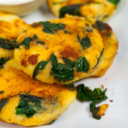 leftover: Leftover Mashed Potato Cakes With Spinach. Selective focus.