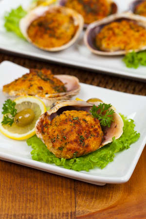 crab: Baked Stuffed Clams. Selective focus.