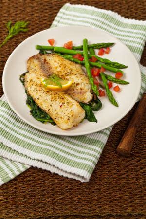 whitefish: Whitefish with Roasted Asparagus. Selective focus. Stock Photo