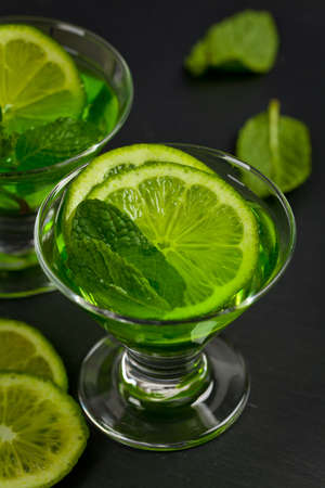 sweet vermouth: A shot of Green Vodka with Lime and Mint. Selective focus.