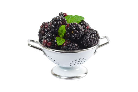colander: Blackberry in a Colander Isolated on white background. Selective focus