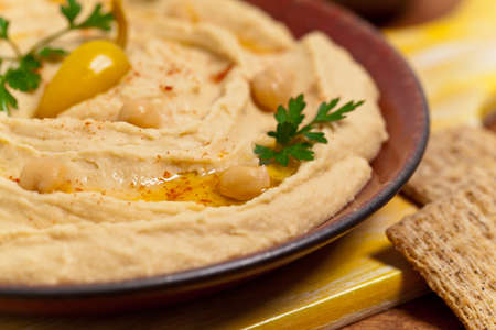 sesame cracker: Hummus Dip with Olive Oil. Selective focus.