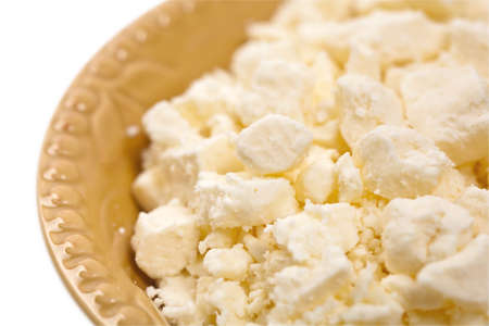 crumbled: Feta Crumbled Cheese Isolated on White. Selective focus. Stock Photo