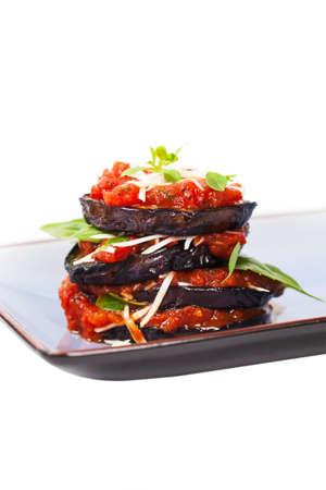 layered: Layered Italian Eggplant Appetizer on White Background. Selective focus. Stock Photo