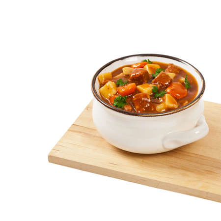 Slow Cooker Beef Stew Isolated on white. Selective focus. Stock Photo
