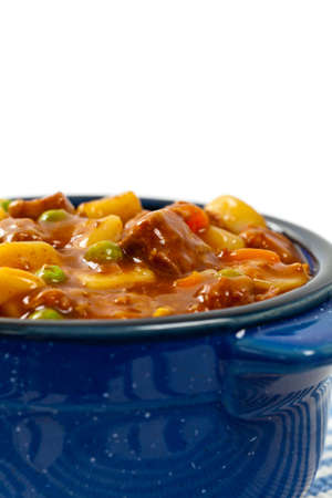 slow cooker: Slow Cooker Beef Stew Isolated on white. Selective focus. Stock Photo