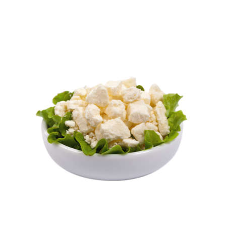 Feta Crumbled Cheese Isolated on White. Selective focus. Stock Photo