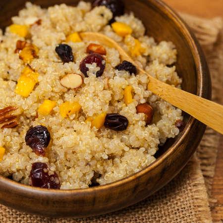 Quinoa Porridge with Pumpkin, Nuts and Dried Fruit. Selective focus.
