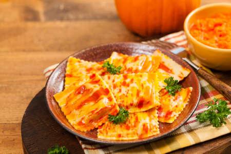 tortellini: Roasted Pumpkin and Bell Pepper Ravioli. Selective focus. Stock Photo