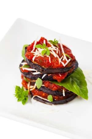marinara sauce: Layered Italian Eggplant Appetizer on White Background. Selective focus. Stock Photo